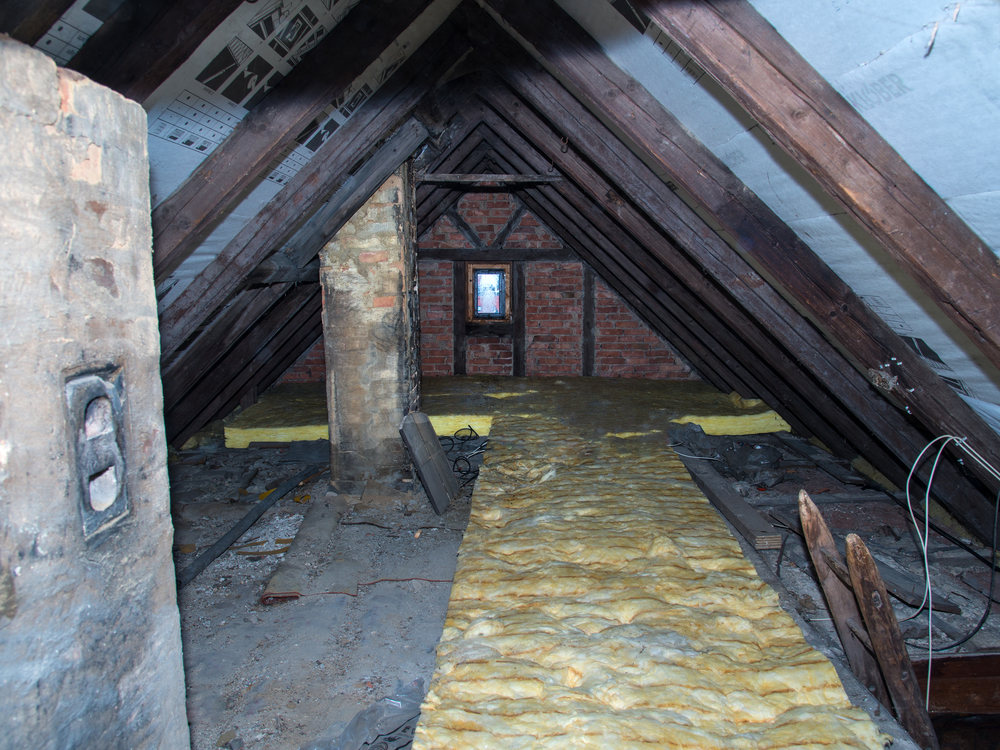 Dave´s Insulation of Washtington DC inspecting an attic that requires an upgrade